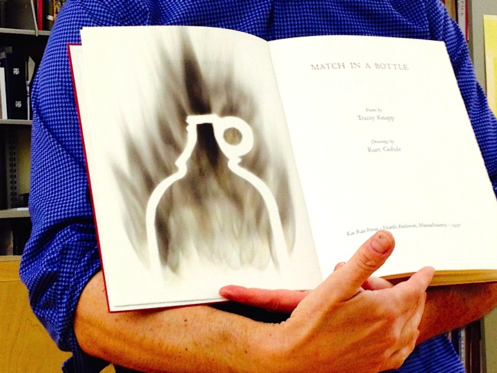 John Cutrone Shows Pages of a Book, created with heat and fire  (Photo Courtesy of Rickie Leiter)