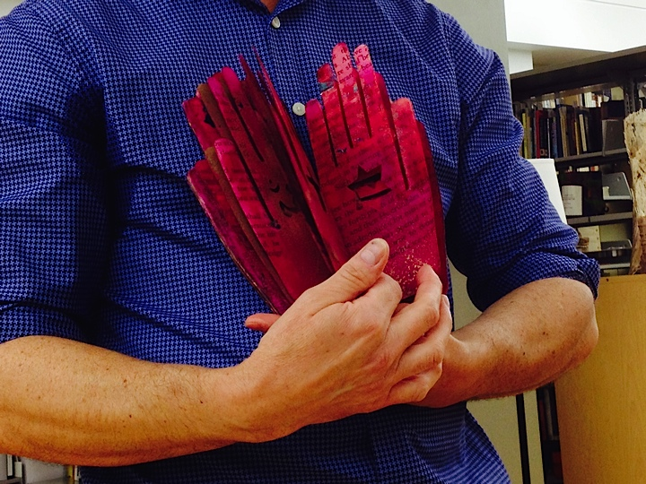 """John Cutrone shows Various Pages of """"Prayer Book""""  (Photo courtesy of Candace Kahan"""