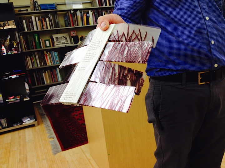 John Cutrone demonstrates Book Pages flapping - part of the story the book tells  (Photo Courtesy Rickie Leiter)