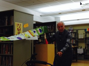Arthur Jaffe holds end of symbol story book  (Photos courtesy of Rickie Leiter)