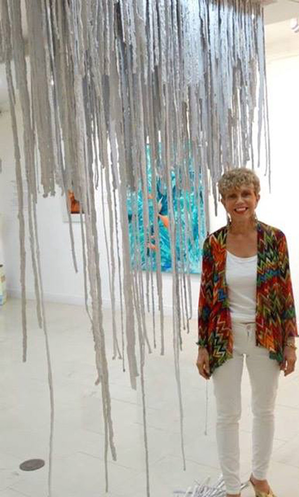 Del Foxton standing beneath her art installation