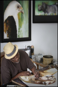 Anthony Burks working on a painting